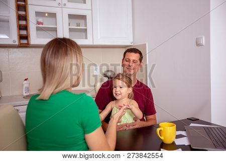 Happy Family - Smiling Woman And Man Playing With Their Girl At Home