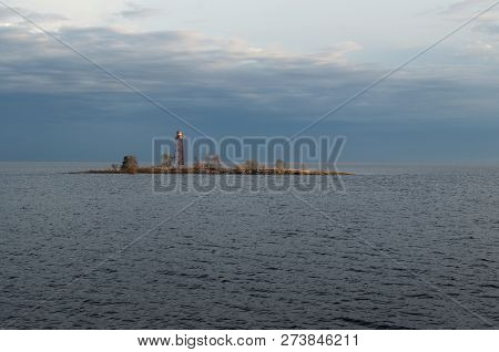 Small Lighthouse. It Is A Lighthouse On A Small Island On The Lake