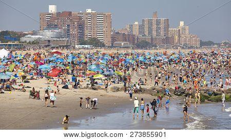New York, Usa - July 02, 2018: Crowded Coney Island Beach On A Warm, Hazy Day.