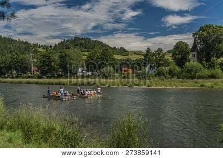 Wooden Boats On Dunajec River In Pieniny National Park Near Poland And Slovakia Border In Summer Day