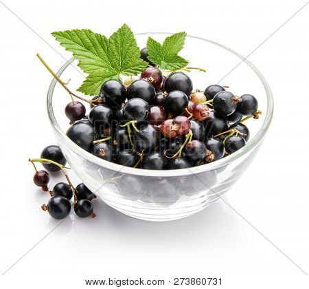 Berry currant in glass dish with green leaves Fruity still life, isolated on white background. poster