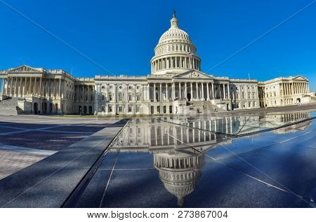 Capitol Building and reflections - Washington DC United States of America