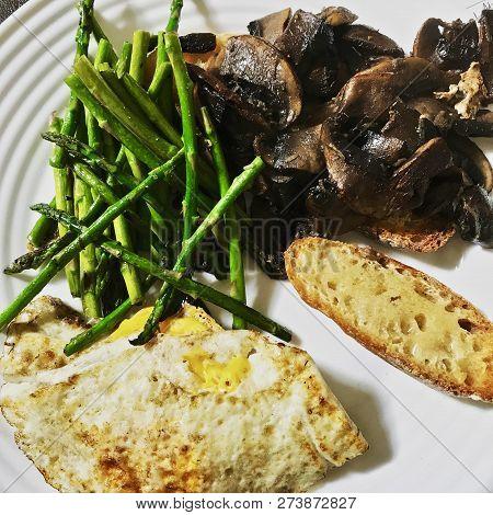 A Vegetarians Great Breakfast Of Portobello Mushrooms, Fresh Baby Asparagus And An Egg On Sourdough