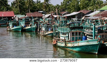Wooden Green And White Fishing Boats In Asia