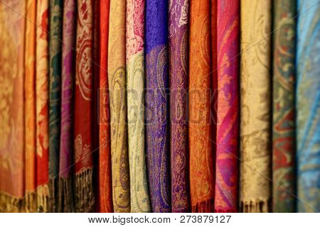 Coloured Rich Patterned Silk Pashminas Hanging Together In Asia
