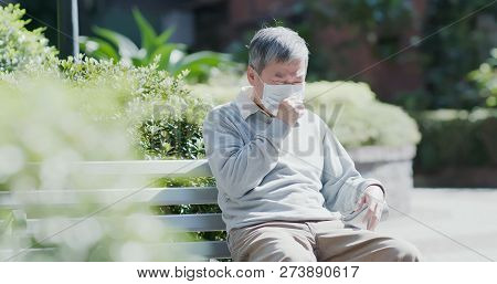 Old Man Wear Mask And Get A Cold And Cough Outdoor