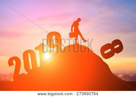 Silhouette Of Business Man On The Moutain With 2019