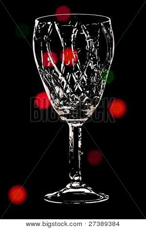 The image of wineglass under the dark background