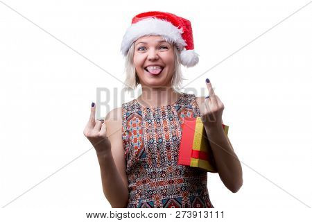Photo of blonde in glasses and Santa's cap with tongue hanging out and gift under arm