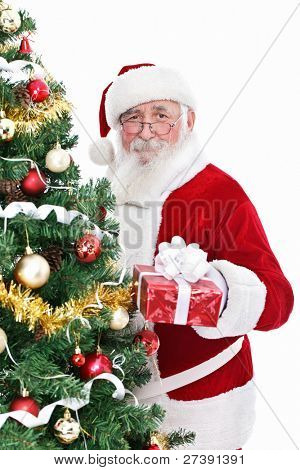 smiling Santa Claus with real beard holding gift for Christmas