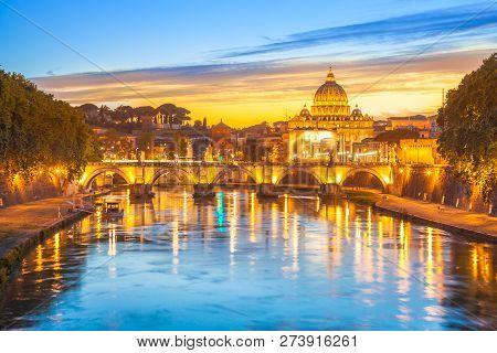 Cityscape Of Rome At Twilight With San Pietro Cathedral, Santangelo Bridge And Tevere River Illumina