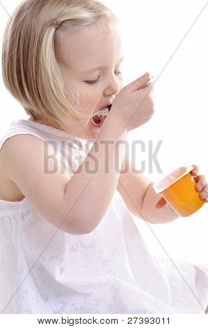Little Girl Eating Yogurt, Mouth Wide Open