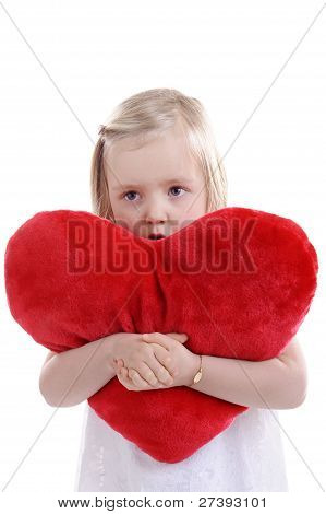 Little Girl With Big Red Heart Shaped Pillow In Her Arms