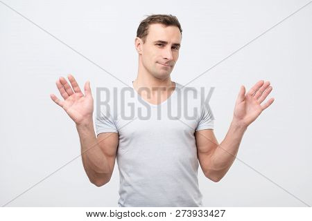 Confused Italian Man Is Unsure Having Some Doubts Standing In Studio