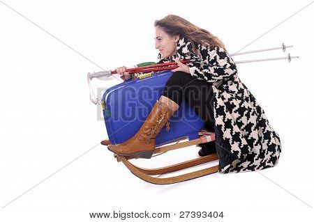 Young Woman With Suitcase On Sledge