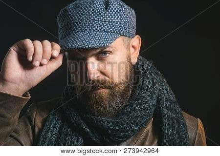 Men Winter Fashion. Handsome Man Wearing Scarf, Hat, Jacket. Casual Look. Trendy Man In Cap. Men's C