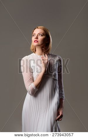 Pensive Blonde Lady In Fashionable White Dress. Beauty, Fashion. Sexy Woman In Lace White Dress. Tho