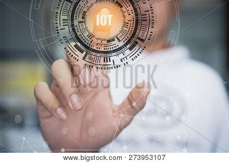 Internet Of Things / Iot Concept. Businessman Touching Presented Symbol Connected Icons Iot Over Tec