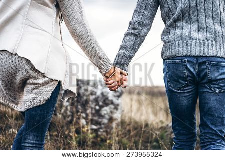 Photo Of Romatic Couple Hands, Walking Outdoor And Spending Time Together.