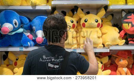 Tokyo, Japan - August 2018: Unidentified Man Looking At Plush Pokemon Toys At The Pokemon Center Sto