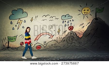 Casual Woman Starting A Life Quest With Obstacles Drawn On Wall. Self Overcome Imaginary Climbing Mo