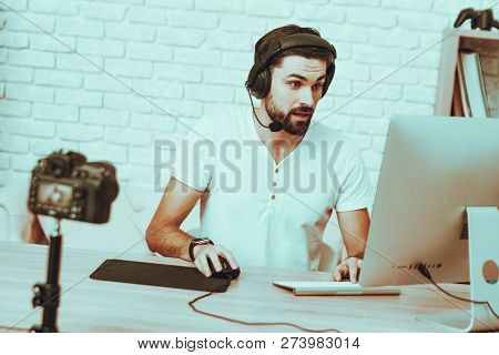 Blogger Makes A Video. Blogger Is Gamer. Blogger Is Young Beard Man. Camera Shoots A Video. Man In H