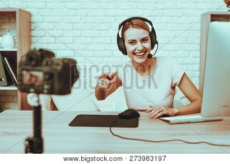 Blogger Makes A Video. Blogger Is Gamer. Blogger Is Smiling Woman. Camera Shoots A Video. Woman In H