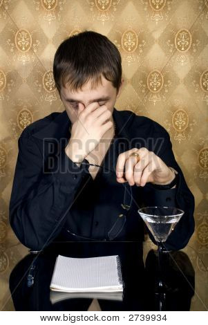 Business Man Drinking In A Restaurant
