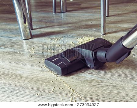 Garbage On The Floor Is Cleaned With A Vacuum Cleaner. In The Frame, A Brush From A Vacuum Cleaner,
