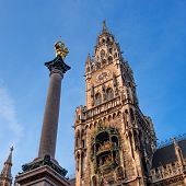 The Marian Column, Clock chimes and the tower of the New Town Hall in Munich, Germany poster