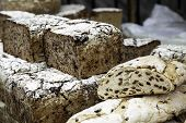 Large artisan breads, traditional bakery detail in market poster