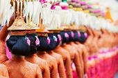 Group of beautiful Balinese women in costumes - sarong, carry offering for Hindu ceremony. Traditional dances, arts festivals, culture of Bali island and Indonesia people. Indonesian travel background poster