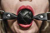 Gag in mouth. Bdsm and fetish concept poster