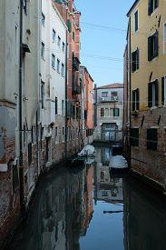 Back Alley Waterway In Venice, Italy. Vertical Shot.
