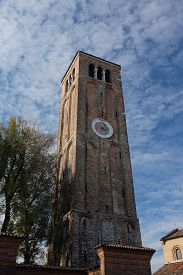 Belltower Of The Santa Maria E San Donato In Murano (venetian Lagoon, Italy).