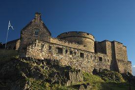 Battlements Within The Grounds Of Edinburgh Castle (edinburgh, Scotland, Uk) Against A Deep Blue Sky
