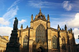 St. Giles Cathedral In Bright Daylight Against A Deep Blue Sky, With Statue Of Walter Montagu Dougla
