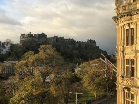 Early Morning Cityscape Of Edinburgh (scotland, Uk) With Castle In Distance As Seen From Princes Str