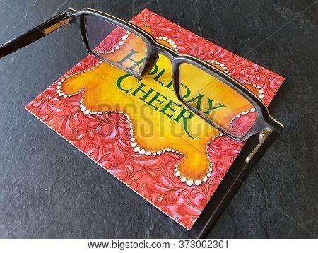 Cluj-napoca, Romania - April 12, 2020: Illustrative Editorial - Reading Glasses On Holiday Book, Aft