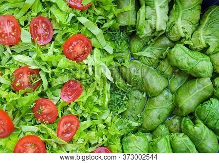 Green Orache Meat Rolls, Salad Leaves And Red Cherry Tomato Slices, Packed Together In Pot Before He