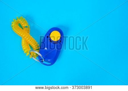 Blue Clicker, Special Tool For Dog Training, On Positive Motivation And Reinforcement. Blue Backgrou