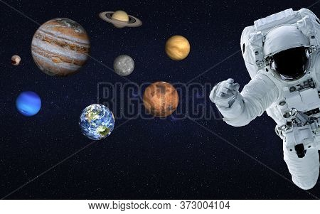 Astronaut Near Planets Of Solar System Together In Space. Earth, Mars, Venus, Mercury, Saturn, Jupit