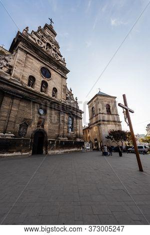 Lviv, Ukraine - October 23, 2019: Crucifix In Front Of St Andrews Catholic Church