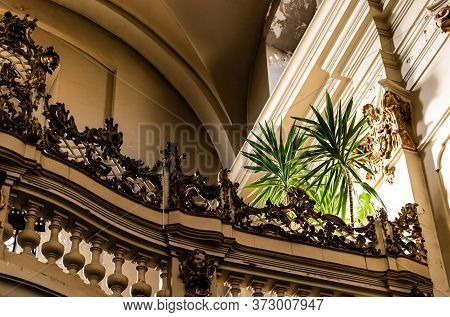 Lviv, Ukraine - October 23, 2019: Balcony With Balustrade And Natural Plants In Dominican Church