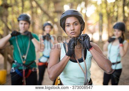 Portrait of trainee wearing protective helmet