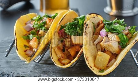 tasty grilled pineapple and chicken street tacos in metal tray