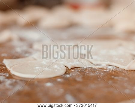 Kneading The Dough. Rolling Pin And Rolling Out The Dough. Flour Dough. Cooking In The Kitchen.