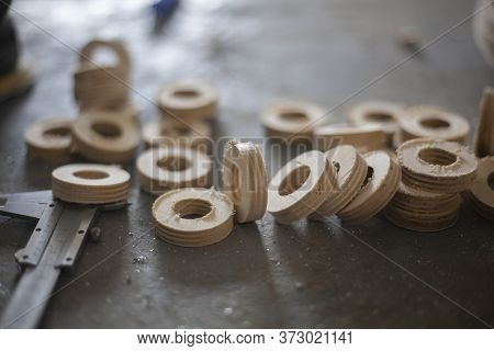 Wooden Circles. Blanks For Threading The Cord Through Wooden Rings. Products On A Cutting Plotter. M