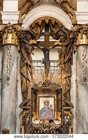 Lviv, Ukraine - October 23, 2019: Icon And Crucifix Between Marble Columns With Gilded Decoration In