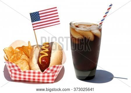Hot Dog. Hot Dog and Cola Flavored Soda Pop. Isolated on white. Room for text. Hot Dog with Mustard, Potato Chips, American Flag and Iced Soda Pop with a red white and blue paper straw.